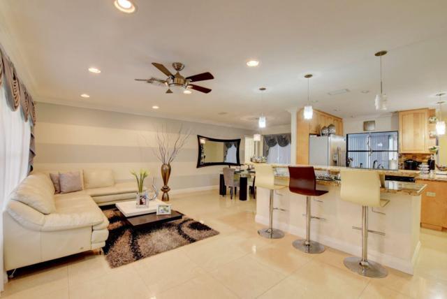 5015 N Woodstone Circle N, Lake Worth, FL 33463 (MLS #RX-10522953) :: The Edge Group at Keller Williams