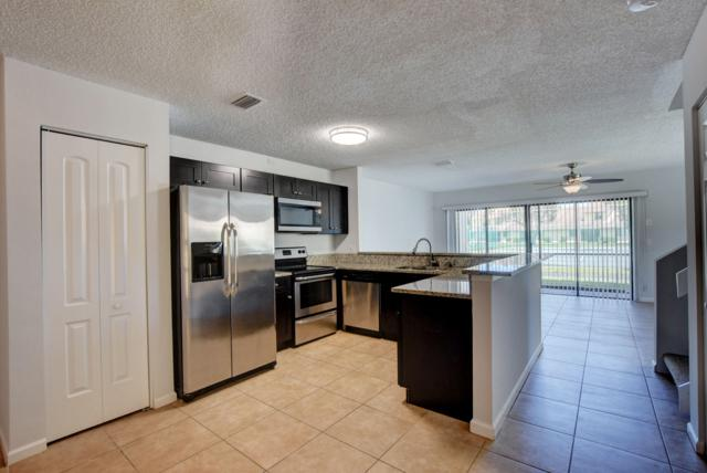 1671 Woodbridge Lakes Circle, West Palm Beach, FL 33406 (MLS #RX-10532113) :: EWM Realty International