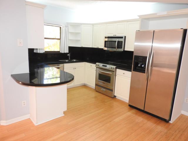 59 Uno Lago Drive, Juno Beach, FL 33408 (MLS #RX-10533175) :: Berkshire Hathaway HomeServices EWM Realty