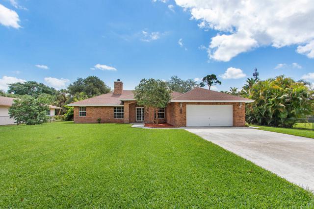 8784 N Virginia Avenue, Palm Beach Gardens, FL 33418 (#RX-10533329) :: Ryan Jennings Group