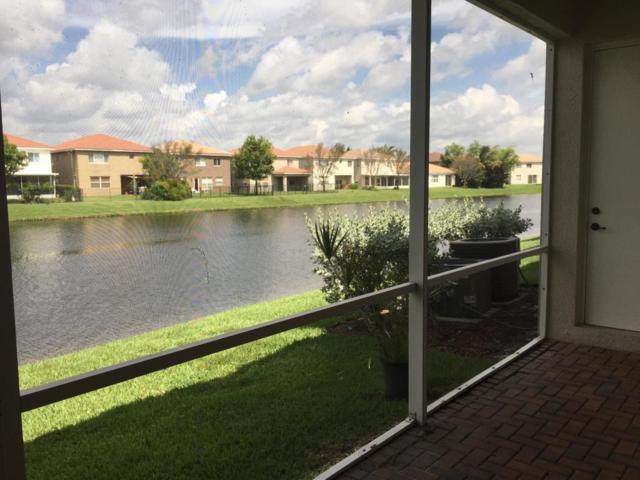 2150 Oakmont Drive, Riviera Beach, FL 33404 (MLS #RX-10536670) :: EWM Realty International