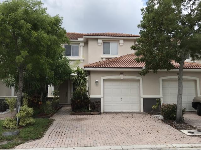 2207 Oakmont Drive, Riviera Beach, FL 33404 (MLS #RX-10537270) :: EWM Realty International