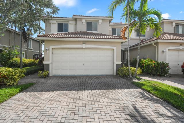 2035 Oakhurst Way, Riviera Beach, FL 33404 (#RX-10548781) :: Weichert, Realtors® - True Quality Service