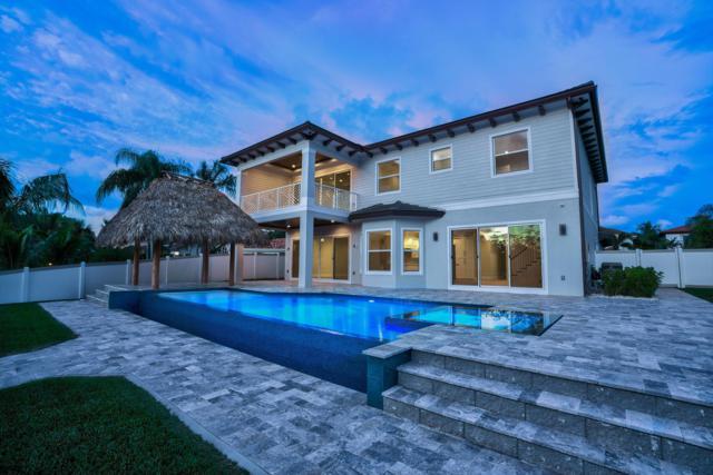 12861 S Shore Drive, West Palm Beach, FL 33410 (#RX-10554196) :: Dalton Wade