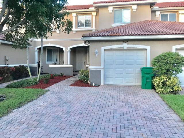 2307 Center Stone Lane, Riviera Beach, FL 33404 (#RX-10554276) :: Weichert, Realtors® - True Quality Service