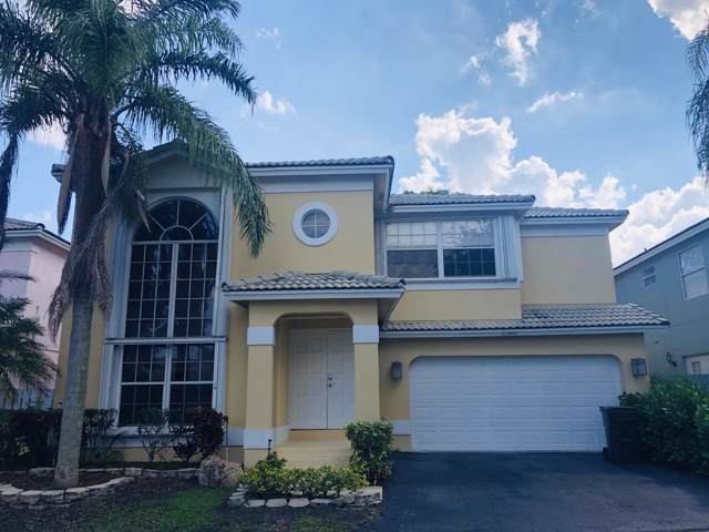 5380 NW 41st Way, Coconut Creek, FL 33073 (MLS #RX-10571730) :: The Paiz Group
