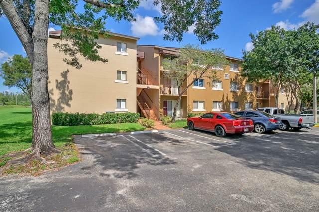 1215 N Benoist Farms Road #103, West Palm Beach, FL 33411 (#RX-10573995) :: Ryan Jennings Group