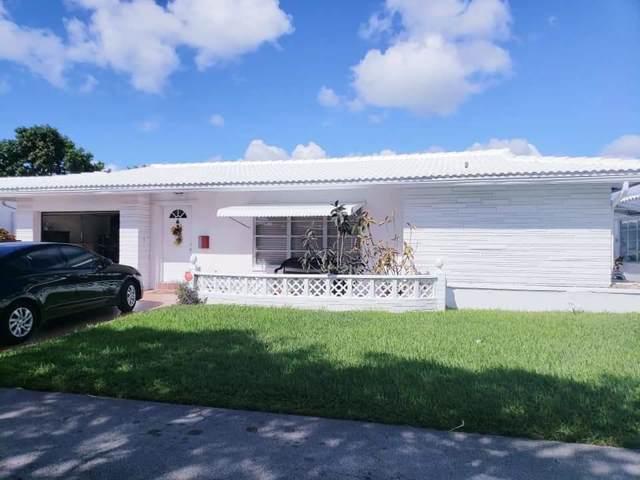 8109 NW 59th Street, Tamarac, FL 33321 (MLS #RX-10575595) :: Berkshire Hathaway HomeServices EWM Realty