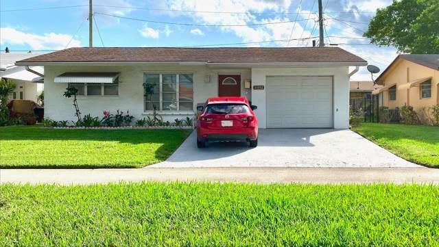 2402 NW 54th Street, Tamarac, FL 33309 (MLS #RX-10576815) :: Berkshire Hathaway HomeServices EWM Realty