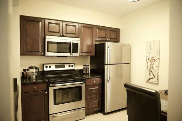 1110 Lake Shore Drive #102, Lake Park, FL 33403 (#RX-10600179) :: Ryan Jennings Group