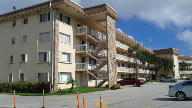 300 Village Green Circle S #302, Palm Springs, FL 33461 (#RX-10601479) :: Ryan Jennings Group