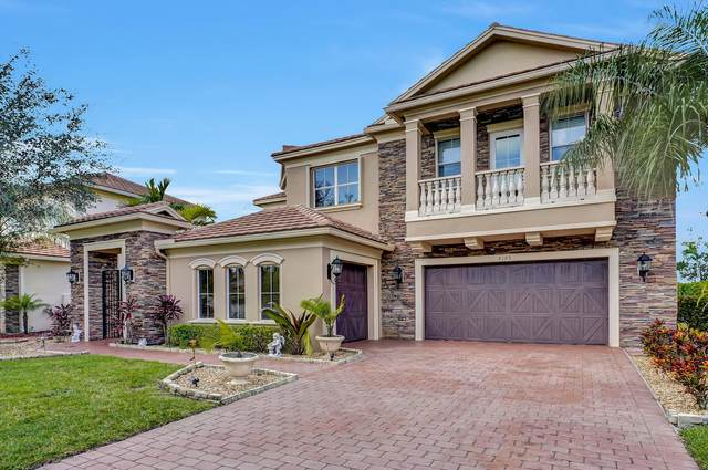 8189 Butler Greenwood Drive, Royal Palm Beach, FL 33411 (MLS #RX-10601796) :: The Jack Coden Group