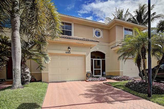 6065 Seminole Gardens Circle, Palm Beach Gardens, FL 33418 (MLS #RX-10602245) :: Berkshire Hathaway HomeServices EWM Realty
