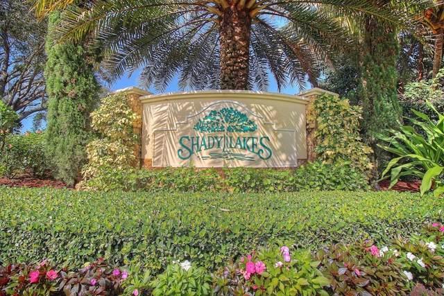 5006 Whispering, Palm Beach Gardens, FL 33418 (#RX-10613027) :: The Rizzuto Woodman Team