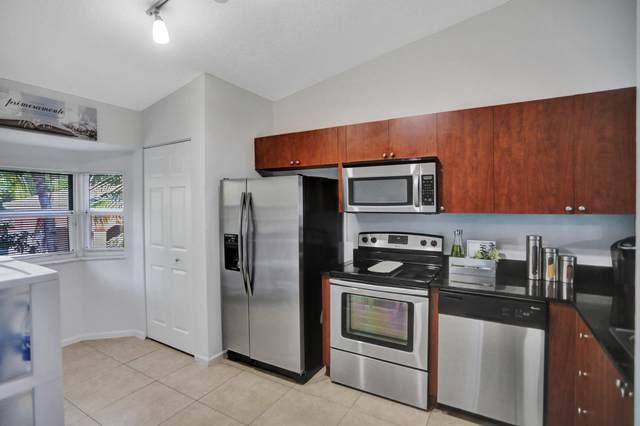 3750 N Jog Rd #204, West Palm Beach, FL 33411 (#RX-10613630) :: Ryan Jennings Group