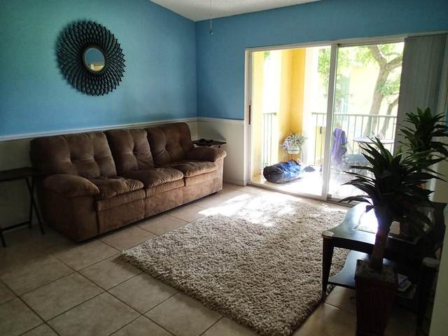 135 Yacht Club Way #202, Hypoluxo, FL 33462 (MLS #RX-10631836) :: Berkshire Hathaway HomeServices EWM Realty