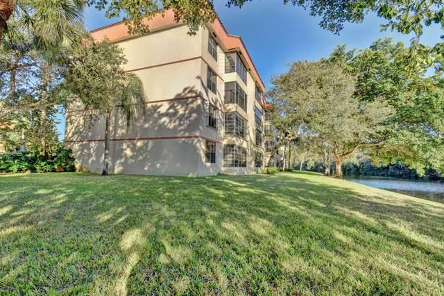 4132 S Carambola Circle S F206, Coconut Creek, FL 33066 (MLS #RX-10638587) :: Berkshire Hathaway HomeServices EWM Realty
