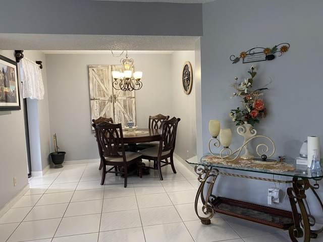 3661 Via Poinciana #106, Lake Worth, FL 33467 (MLS #RX-10646084) :: Berkshire Hathaway HomeServices EWM Realty