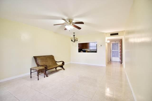 701 Lori Drive #112, Palm Springs, FL 33461 (MLS #RX-10648296) :: Berkshire Hathaway HomeServices EWM Realty