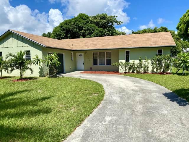 303 Elaine Circle W, West Palm Beach, FL 33409 (MLS #RX-10649906) :: The Paiz Group
