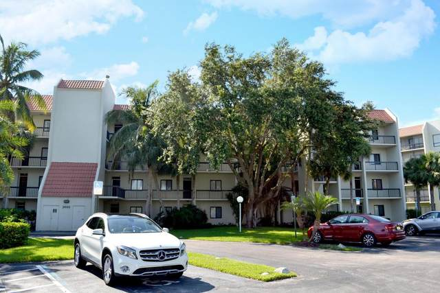 3050 Presidential Way #401, West Palm Beach, FL 33401 (MLS #RX-10656410) :: Berkshire Hathaway HomeServices EWM Realty