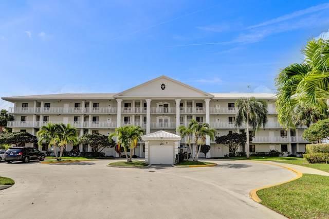 2401 Village Boulevard #302, West Palm Beach, FL 33409 (MLS #RX-10659463) :: Castelli Real Estate Services