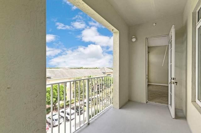 1203 Town Center Drive #401, Jupiter, FL 33458 (#RX-10659635) :: Posh Properties
