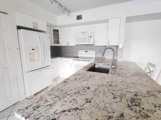 1801 N Flagler Drive #236, West Palm Beach, FL 33407 (MLS #RX-10660748) :: Berkshire Hathaway HomeServices EWM Realty