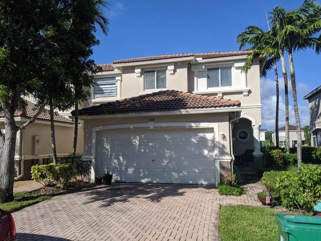 2154 Oakmont Drive, Riviera Beach, FL 33404 (MLS #RX-10661986) :: Berkshire Hathaway HomeServices EWM Realty