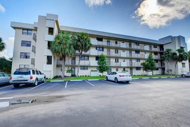2410 Deer Creek Country Club Boulevard 108-E, Deerfield Beach, FL 33442 (MLS #RX-10662238) :: Berkshire Hathaway HomeServices EWM Realty