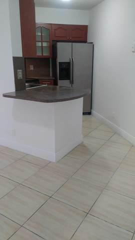 212 Lake Pointe Drive #211, Oakland Park, FL 33309 (MLS #RX-10664929) :: Castelli Real Estate Services