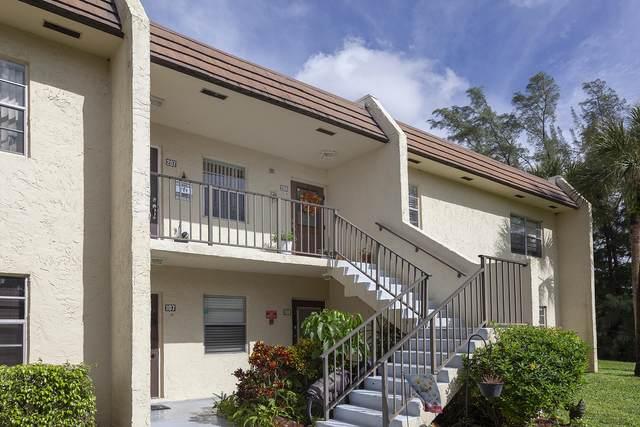 100 Lake Meryl Drive #208, West Palm Beach, FL 33411 (MLS #RX-10670897) :: Berkshire Hathaway HomeServices EWM Realty