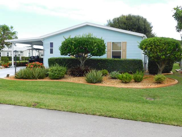 8000 Meadowlark Lane, Port Saint Lucie, FL 34952 (#RX-10673694) :: The Rizzuto Woodman Team