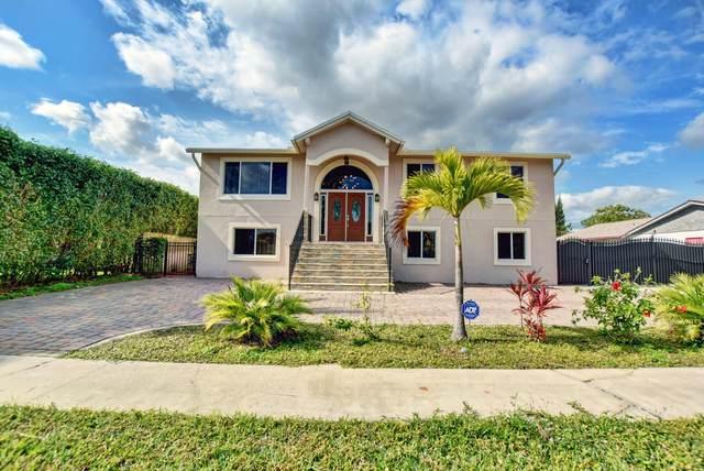 1371 Woodcrest Road W, West Palm Beach, FL 33417 (MLS #RX-10684486) :: Berkshire Hathaway HomeServices EWM Realty