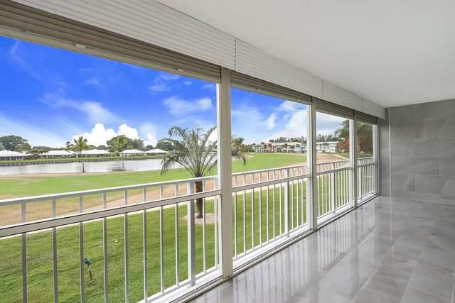 300 John F Kennedy Drive #205, Atlantis, FL 33462 (MLS #RX-10685837) :: Berkshire Hathaway HomeServices EWM Realty