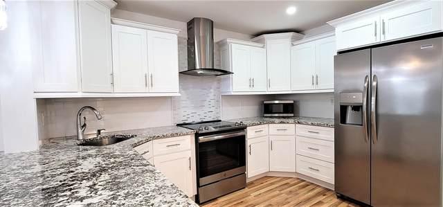 102 Cypress Point Drive #102, Palm Beach Gardens, FL 33418 (MLS #RX-10686316) :: Berkshire Hathaway HomeServices EWM Realty