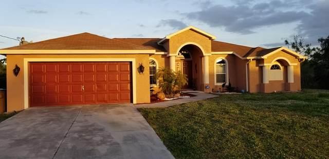 912 Poinsettia Avenue, Lehigh Acres, FL 33972 (#RX-10687639) :: Signature International Real Estate