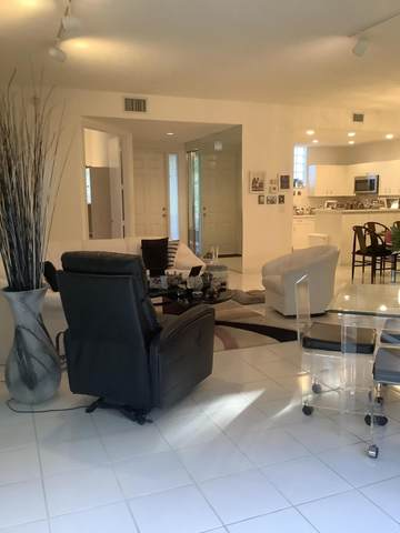 20220 Boca West Drive #204, Boca Raton, FL 33434 (#RX-10697696) :: Treasure Property Group