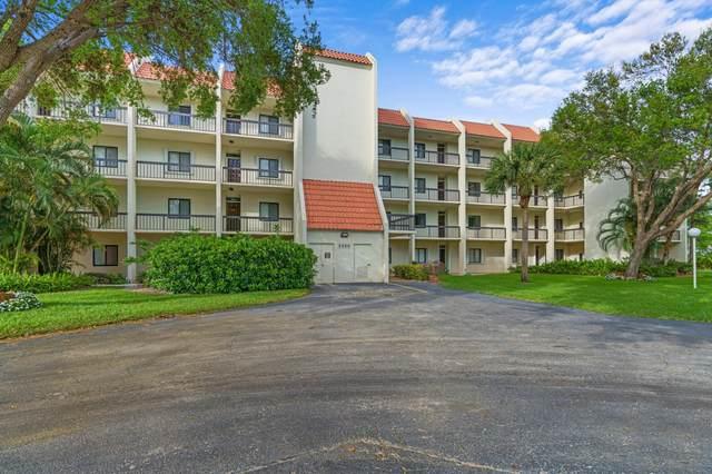 2500 Presidential Way #305, West Palm Beach, FL 33401 (MLS #RX-10698960) :: Berkshire Hathaway HomeServices EWM Realty