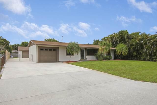 9243 Sun Court, Lake Park, FL 33403 (MLS #RX-10703132) :: The Jack Coden Group