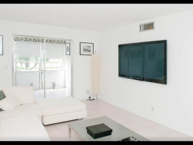 330 NE 26th Avenue #204, Boynton Beach, FL 33435 (MLS #RX-10707106) :: Berkshire Hathaway HomeServices EWM Realty