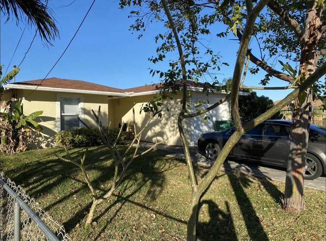 1400 E A C Evans Street, Riviera Beach, FL 33404 (#RX-10708387) :: Posh Properties