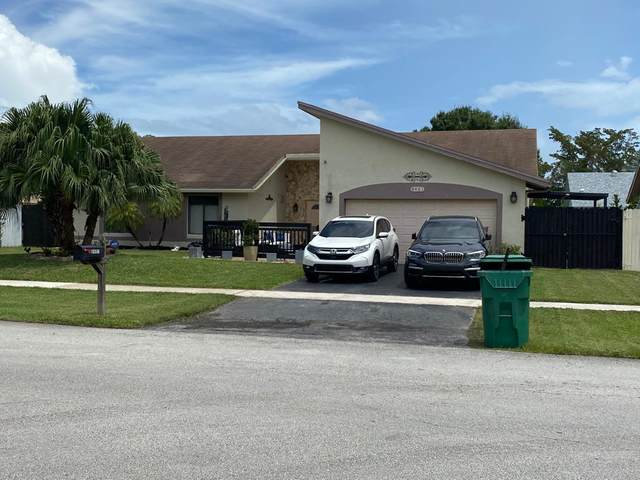 8401 NW 53 Court, Lauderhill, FL 33351 (MLS #RX-10712532) :: Castelli Real Estate Services