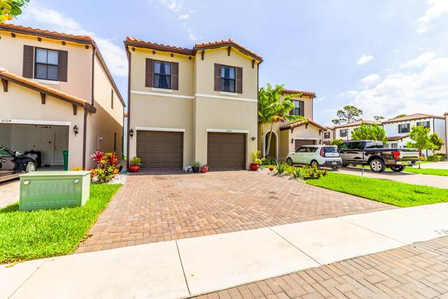 6026 Pine Tree Way, Riviera Beach, FL 33410 (#RX-10714801) :: Ryan Jennings Group