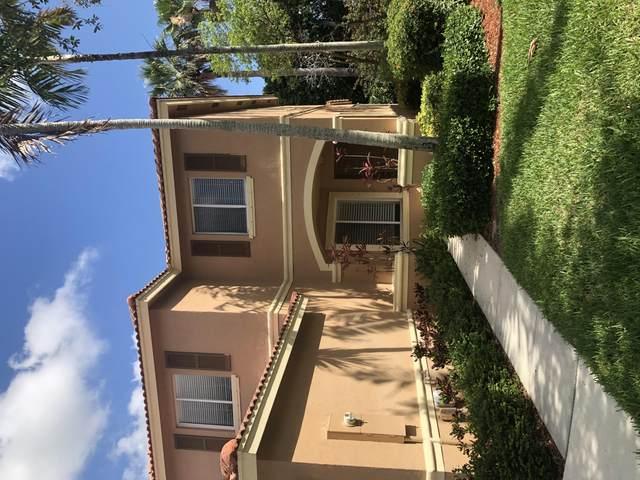 7050 Hawks Nest Terrace, Riviera Beach, FL 33407 (#RX-10715129) :: Posh Properties