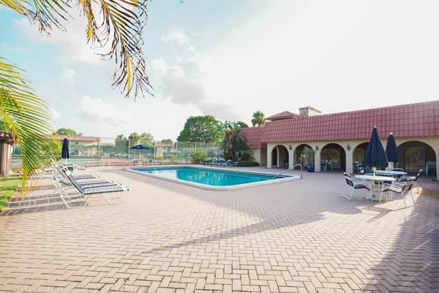 5985 Forest Hill 105 Boulevard #105, West Palm Beach, FL 33415 (MLS #RX-10719136) :: Berkshire Hathaway HomeServices EWM Realty