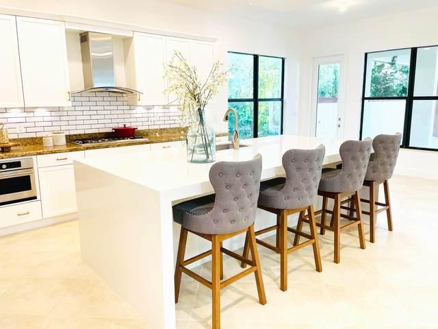 5057 Grandiflora Rd Road, Palm Beach Gardens, FL 33418 (MLS #RX-10723340) :: Berkshire Hathaway HomeServices EWM Realty