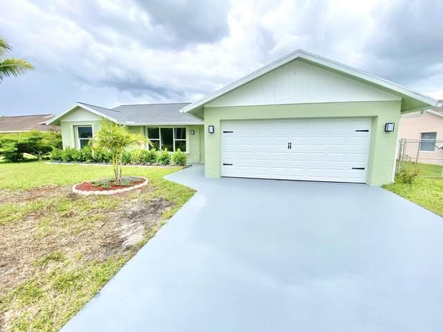 300 La Mancha Avenue, Royal Palm Beach, FL 33411 (#RX-10726482) :: Michael Kaufman Real Estate