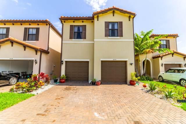 6026 Pine Tree Way, Riviera Beach, FL 33410 (#RX-10729886) :: Michael Kaufman Real Estate