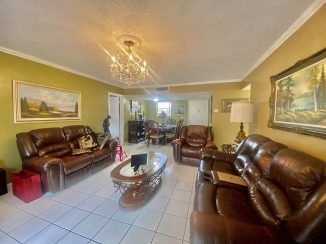 721 Lori Drive #214, Palm Springs, FL 33461 (#RX-10730113) :: Heather Towe   Keller Williams Jupiter